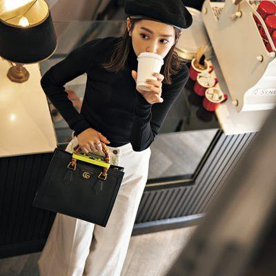 桐谷美玲さんのモノトーンコーデに合う「グッチ」のバッグ