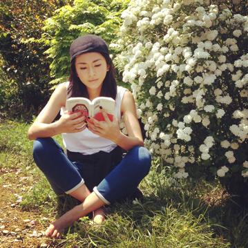 Yoshiko reading a book.JPG